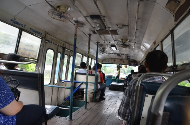 Riding in a bus on the way to Don Hueng Airport, Bangkok.