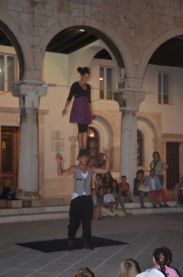 Daring performance by street artistes outside forum, Pula.