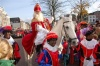 St Nicholas ( Sinterklaas) riding on a horse surrounded by his helpers (Picture courtesy of Phlegmish and Walloony)