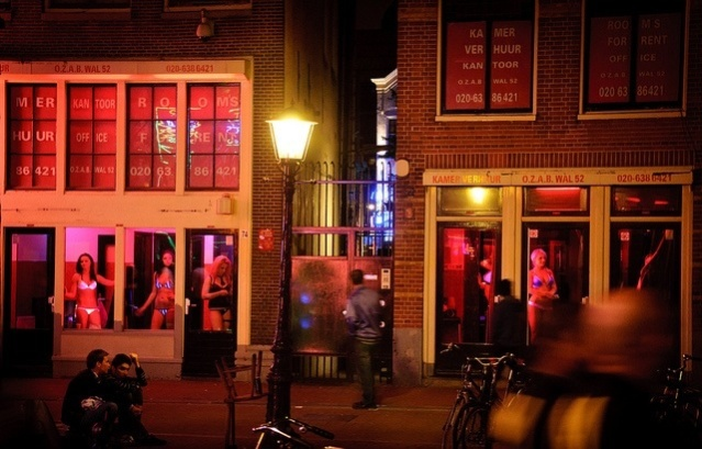 Amsterdam Red Light District windows (picture courtesy of RudmerHK, Flickr)
