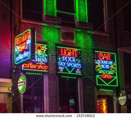 Night image of colourful coffee shop signs in the Red Light District of Amsterdam (Picture courtesy of shutterstock.com).