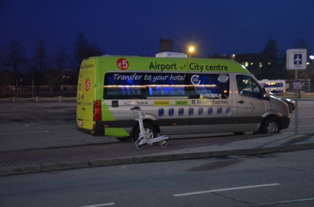 Green taxi outside the arrivals section at Riga Airport, pegged at 5 euros to get you to your hotel.