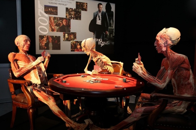 A trio playing poker (image courtesy of Body Worlds Amsterdam, copyright Carolien Sikkenk)