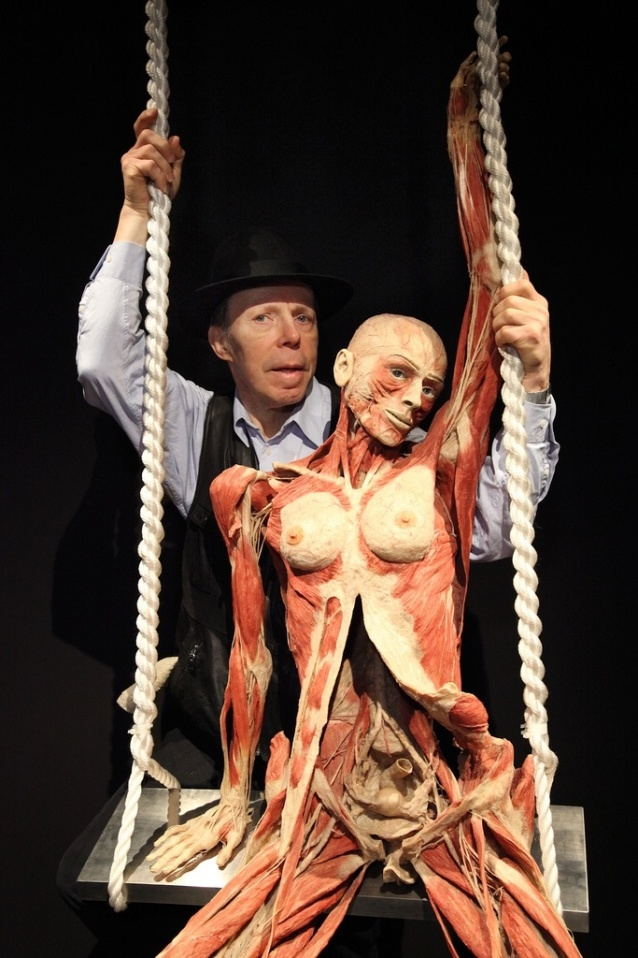 Dr Gunther Von Hagens poses with one of the plastinates