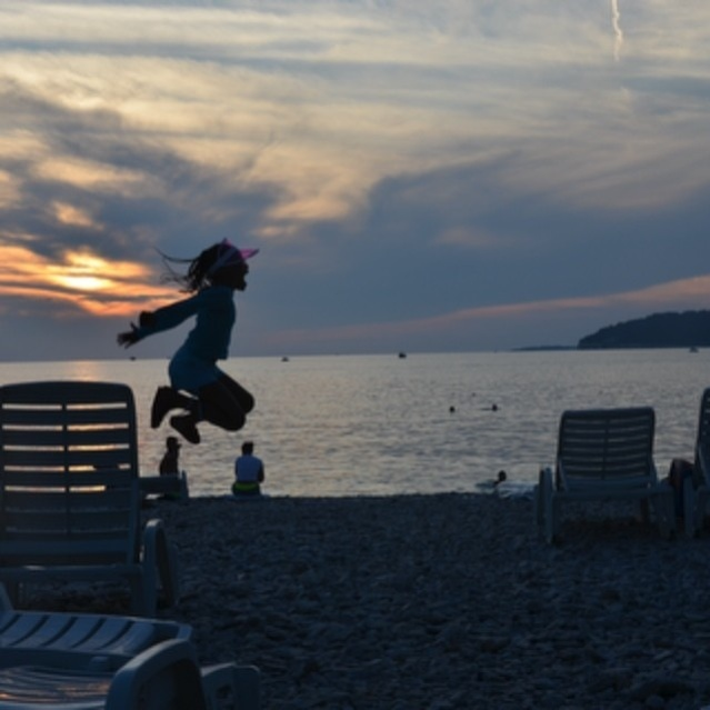 Jumping for joy at the Verudela beach, Pula Croatia