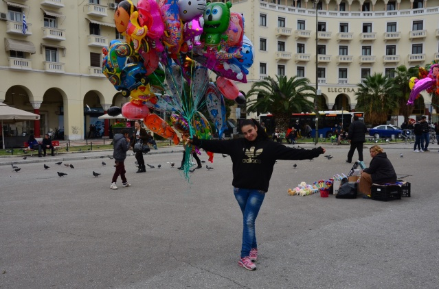 Teenage girl selling helium balloons on Independence Day in Thessaloniki, Greece.