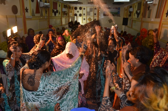 Women dance with bride Aniisa at her wedding, Mogadishu