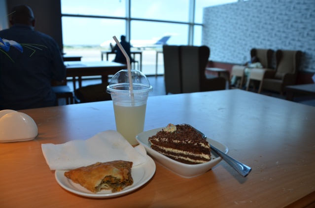 My breakfast of a camel meat samosa, white forest cake and lemonade at the lounge, Mogadishu Airport