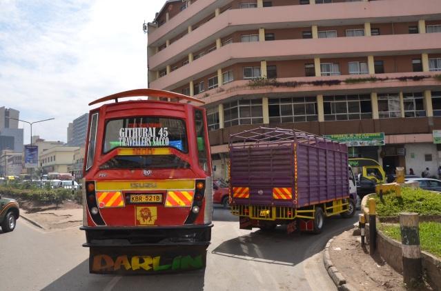 A matatu tries to wange its way out of traffic.
