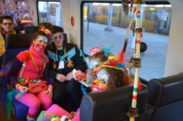 Dutch train goers going to carnival in Eindhoven.