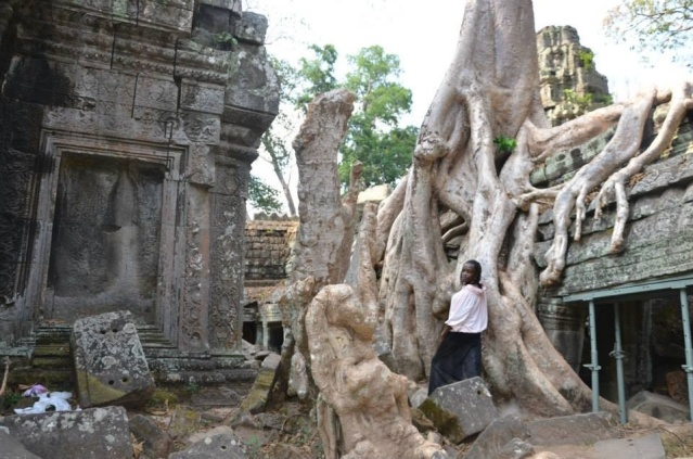 Posing beside huge roots at Angkor Wat, Siem Reap, Cambodia.