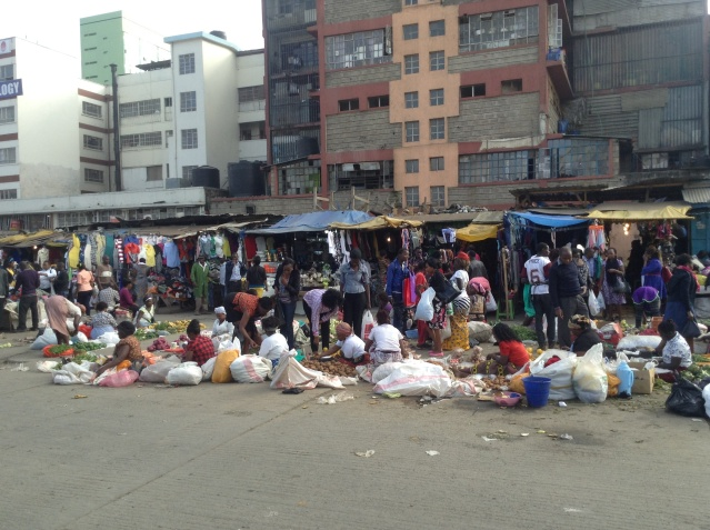 Fruit and vegetable sellers at bus station, Nairobi.