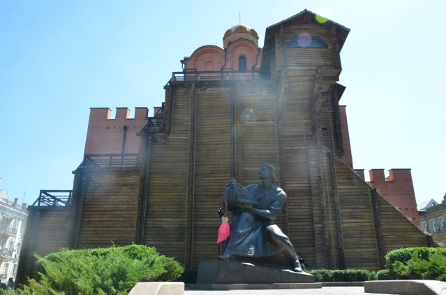 My daughter strikes a pose at the Golden Gates, Kiev.