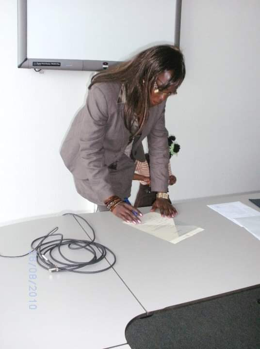 Signing my degree certificate
